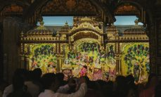 Krishna depicted in a scene at Radha Gopinath Temple