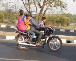 Motor bikes and scooters are main forms of transportation. Here, a family model